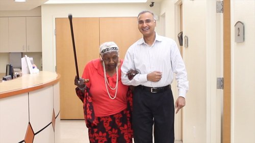 Ms. Dorothy Graham walking with Dr. Reddy in his office in Sugar Land, TX, two years after completing the program.